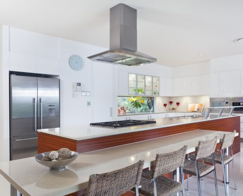 Modern kitchen with stainless steel appliances in Australian mansion